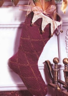 http://www.yarnspirations.com/patterns/burgundy-holiday-stocking.html