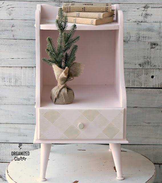 Photo of mid century side table in pale pink