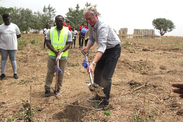 Don Moen cuts sod for $100,000 school project for orphanage