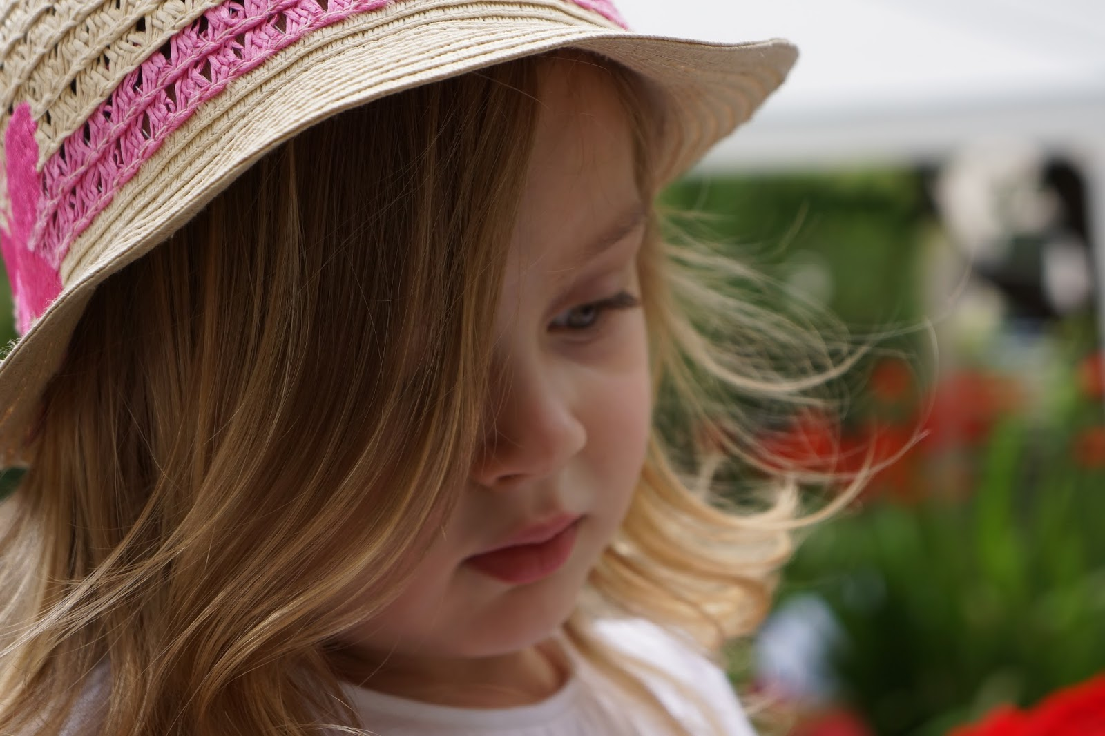 toddler girl wearing a marks and spencers straw hat