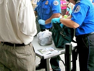 Officers searching a bag.