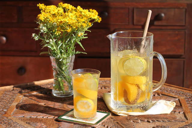 Food Lust People Love: This citrus peach sangria is made with canned peaches, lemons and limes, summer sunshine in a glass so you can enjoy it year round. Make this refreshing favorite for your next family party!