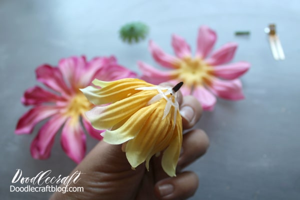 Put the silk flower back together using a brad paper fastener