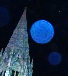 blue orb in sky