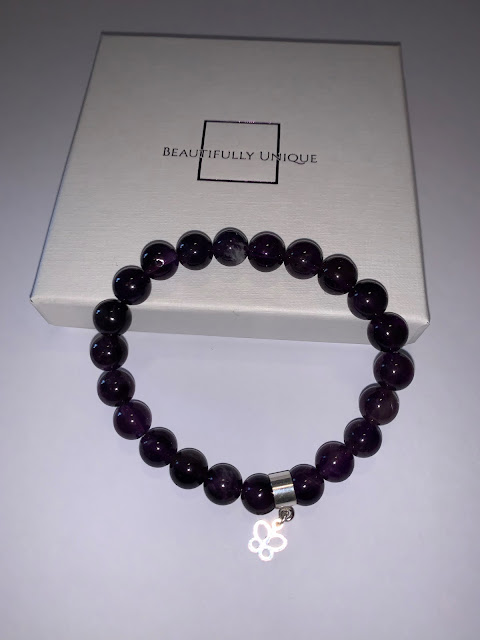 Amethyst semi-precious beaded Stretch bracelet which is complimented with a  Silver Butterfly charm