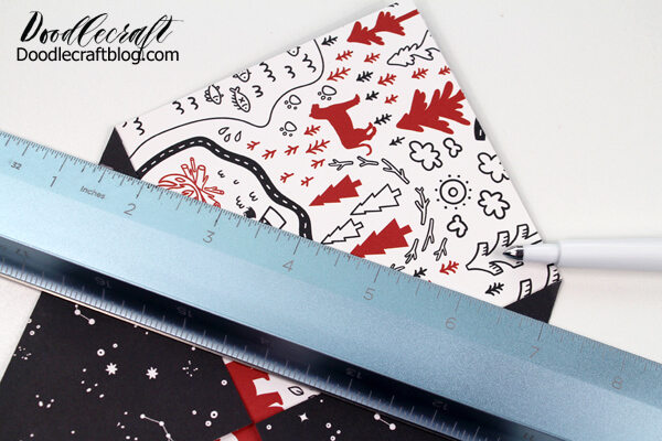 Use a ruler and score stylus to make your own envelopes with patterned paper.