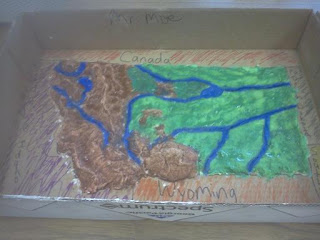 Map is now painted, blue for rivers, green for prairies and brown for mountains.