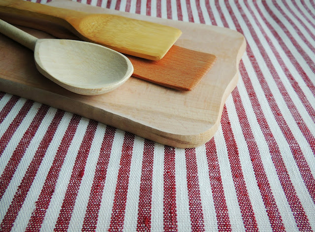 farmhouse wooden spoons spatulas cutting board grainsack towel