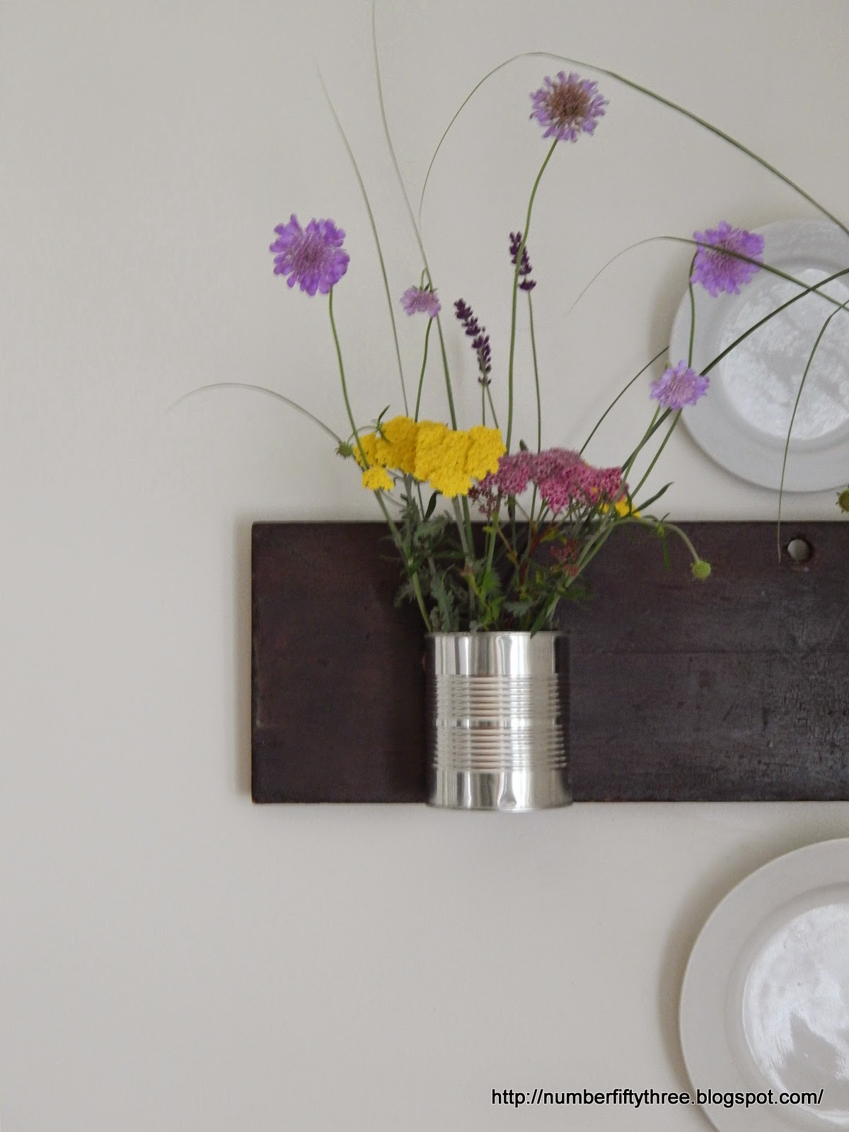 make a reclaimed vase wall haning with recycled cans and an old drawer front.