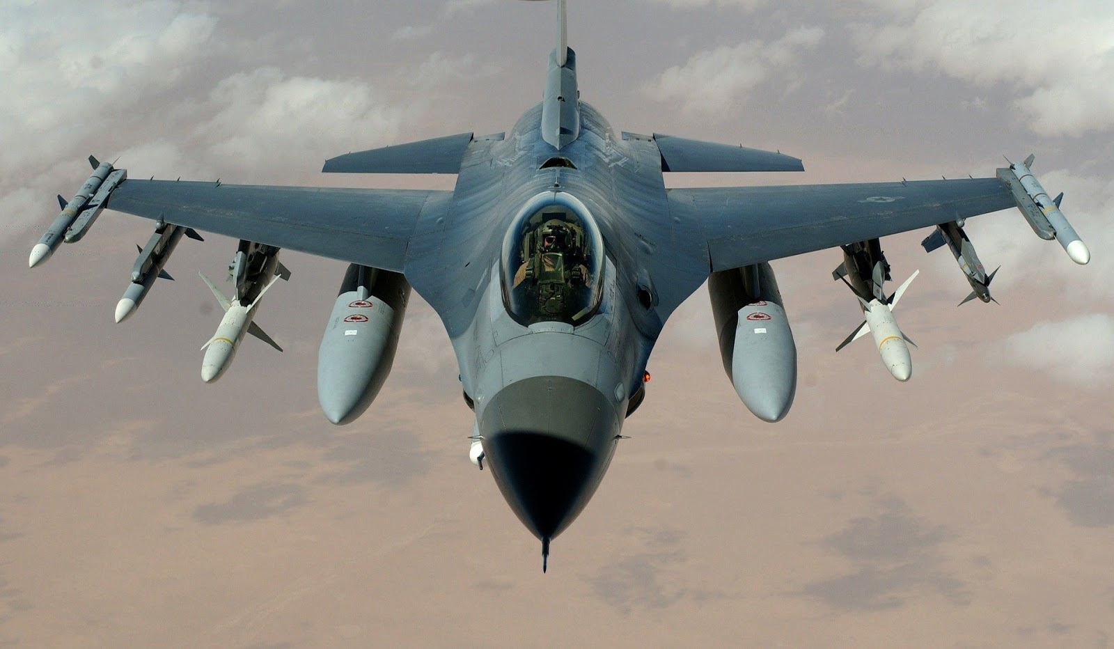 close up of a military fighter jet flying over the desert for blog post about U.S. Air force war movies