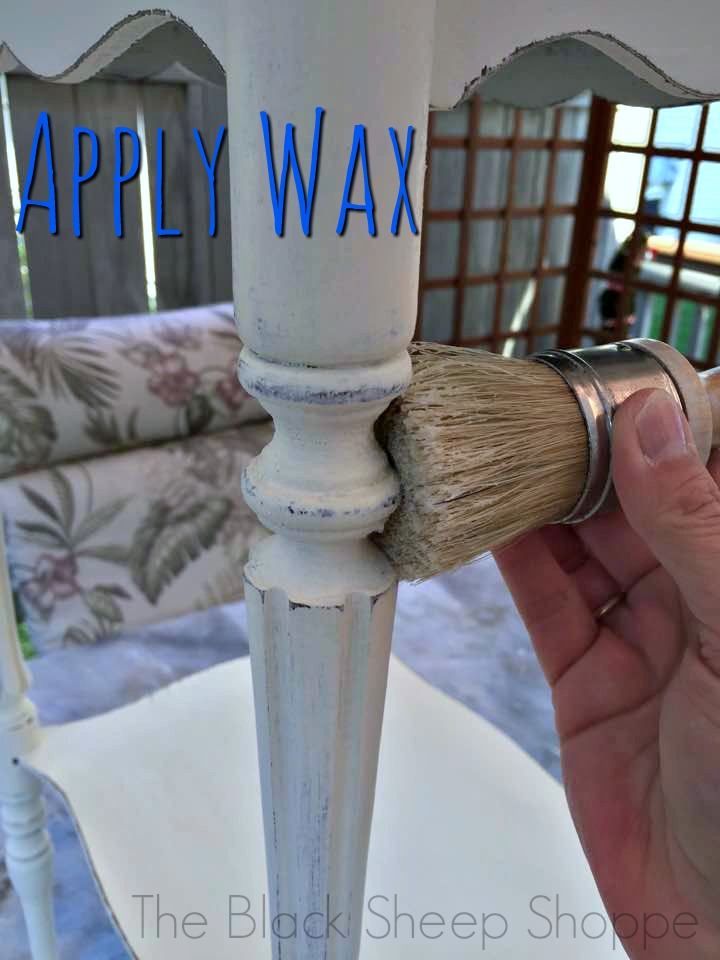 Applying wax with a wax brush.
