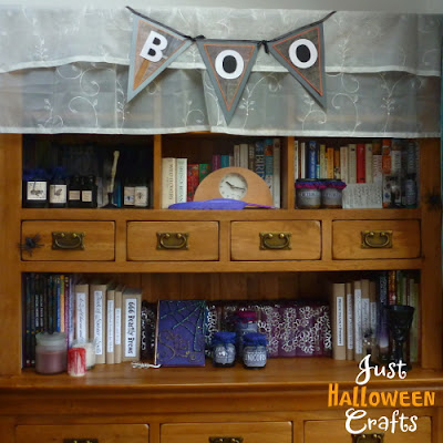 Apothecary cabinet with Halloween banner and props