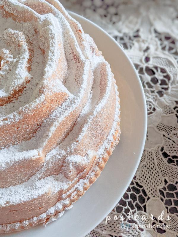 rose shaped Bundt cake sprinkled with powdered sugar