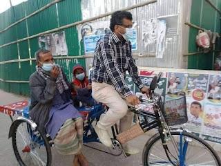 মটর চালিত ভ্যানগাড়ী উপহার দিলেন মেয়র সাইদুল করিম মিন্টু