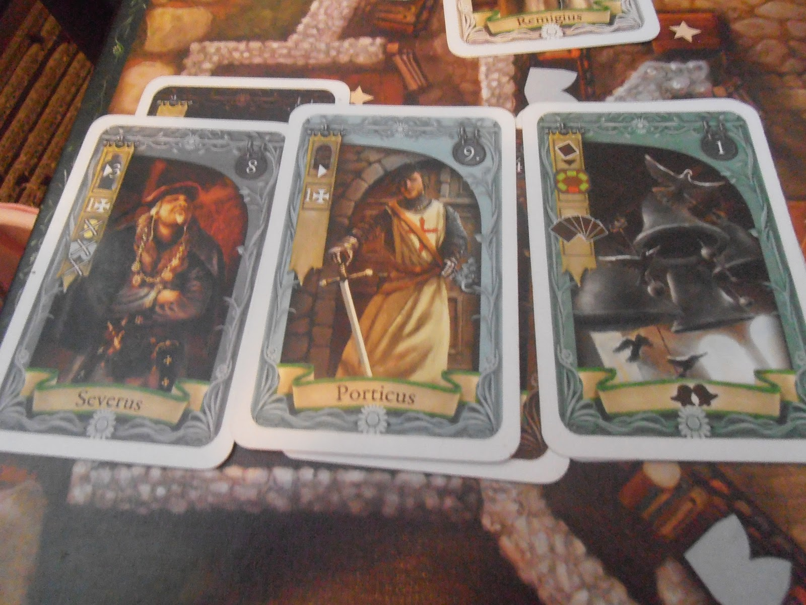 Severus, Porticus and the Bells cards. Templar: Queen Games