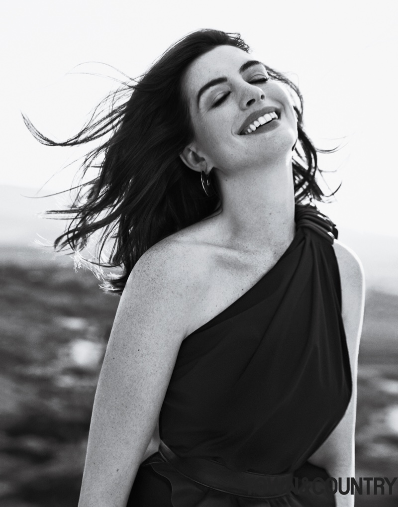Anne Hathaway wears Max Mara dress and Vhernier earrings