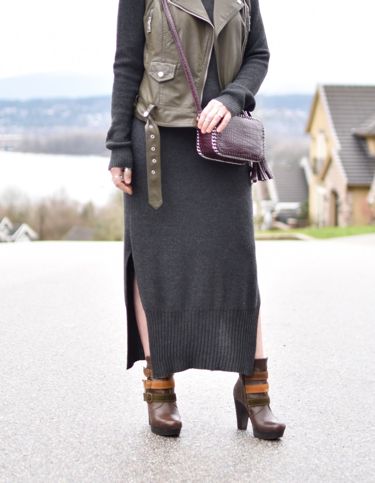 Monika Faulkner outfit inspiration - midi sweater dress, motorcycle vest, platform booties