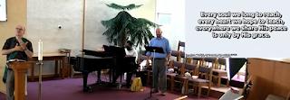 A sign language interpreter with musicians John Gauthier and Dana Scott