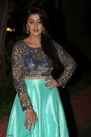 Nikki Galrani in Green Skirt  Top at Marakathamani music launch ~  Exclusive (15).JPG