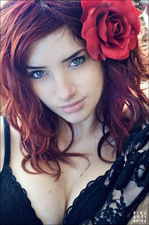 susan-coffey-cleavage-in-black-bra-red-rose-picture