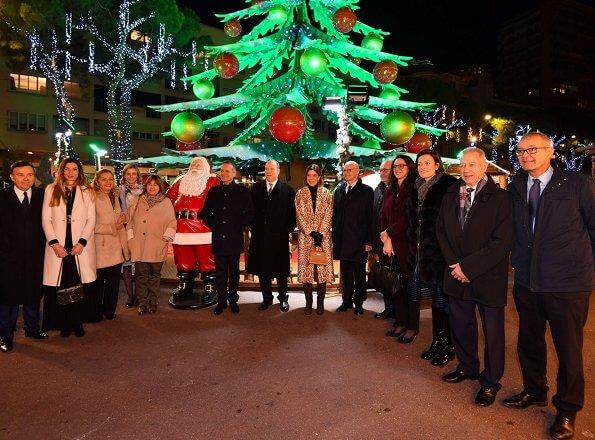 The Christmas village of Monaco 2019 at Hercule Harbour in Monaco. Zimmermann leopard print Denim coat In beige