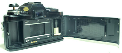 Minolta X-570 (Black) Body #091, [As-Is] Promaster SP 35-70mm F3.5~4.5 Zoom Lens #384