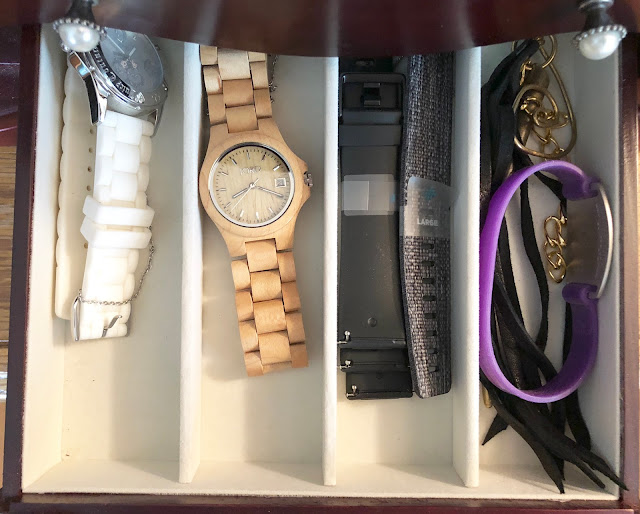 watches in organized jewelry box