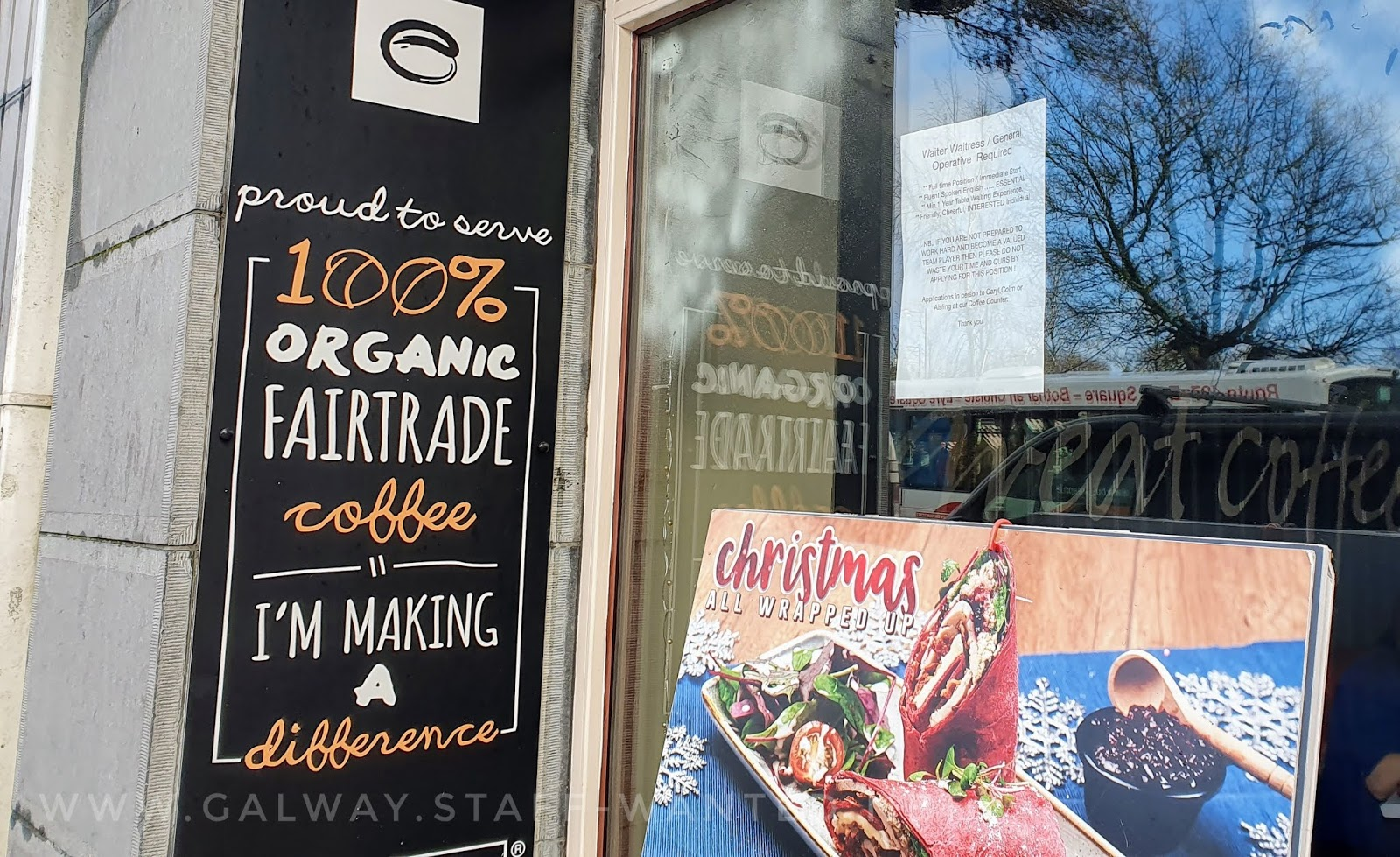 front window of a city centre cafe, with an advertisign sign for their Christmas wrap, made with bright red bread and turkey - Christmas all wrapped up