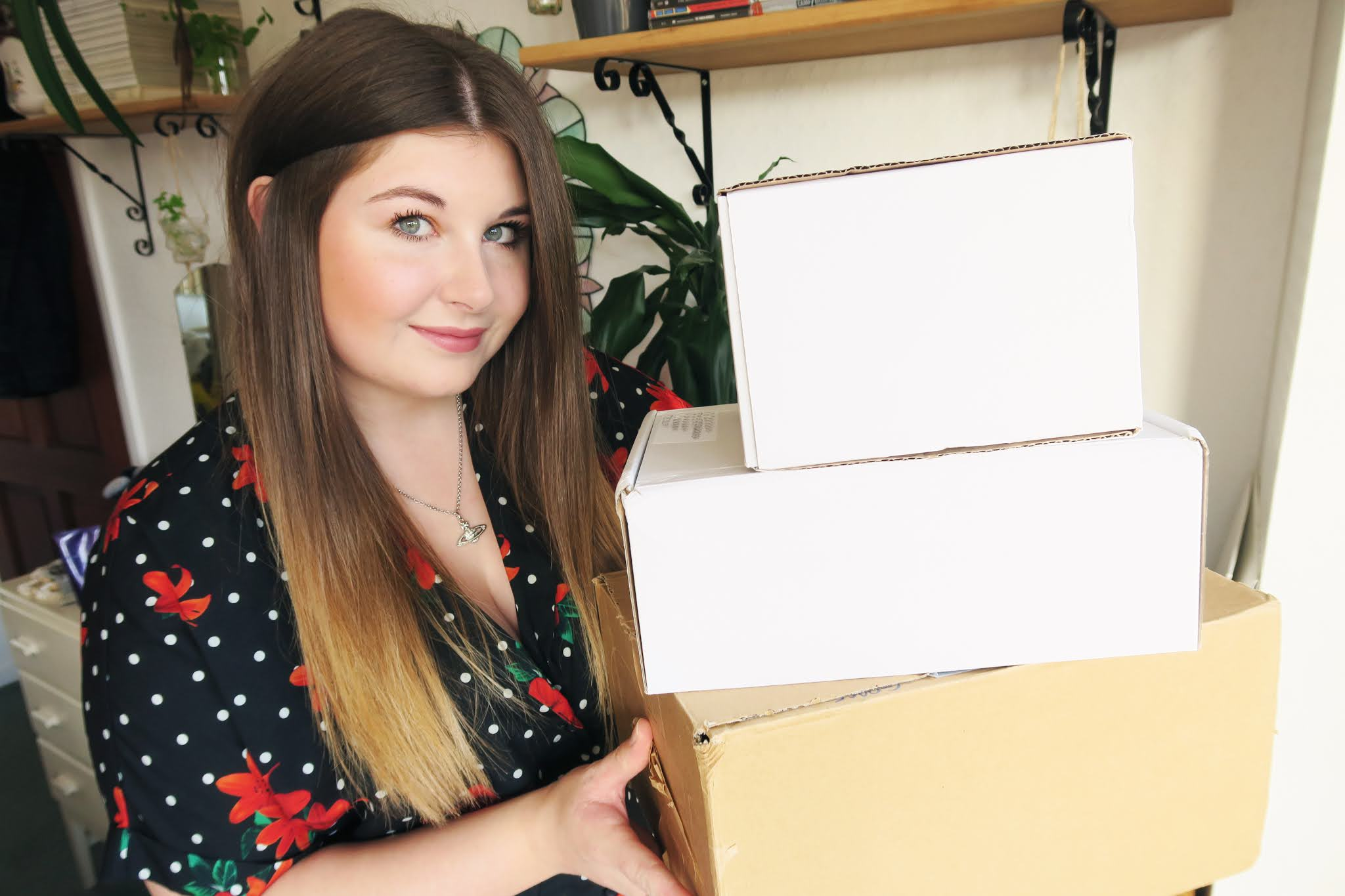 Grace is holding 3 boxes full of free PR products