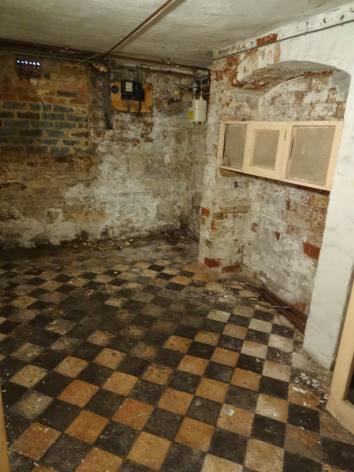 victorian cellar with meat safe