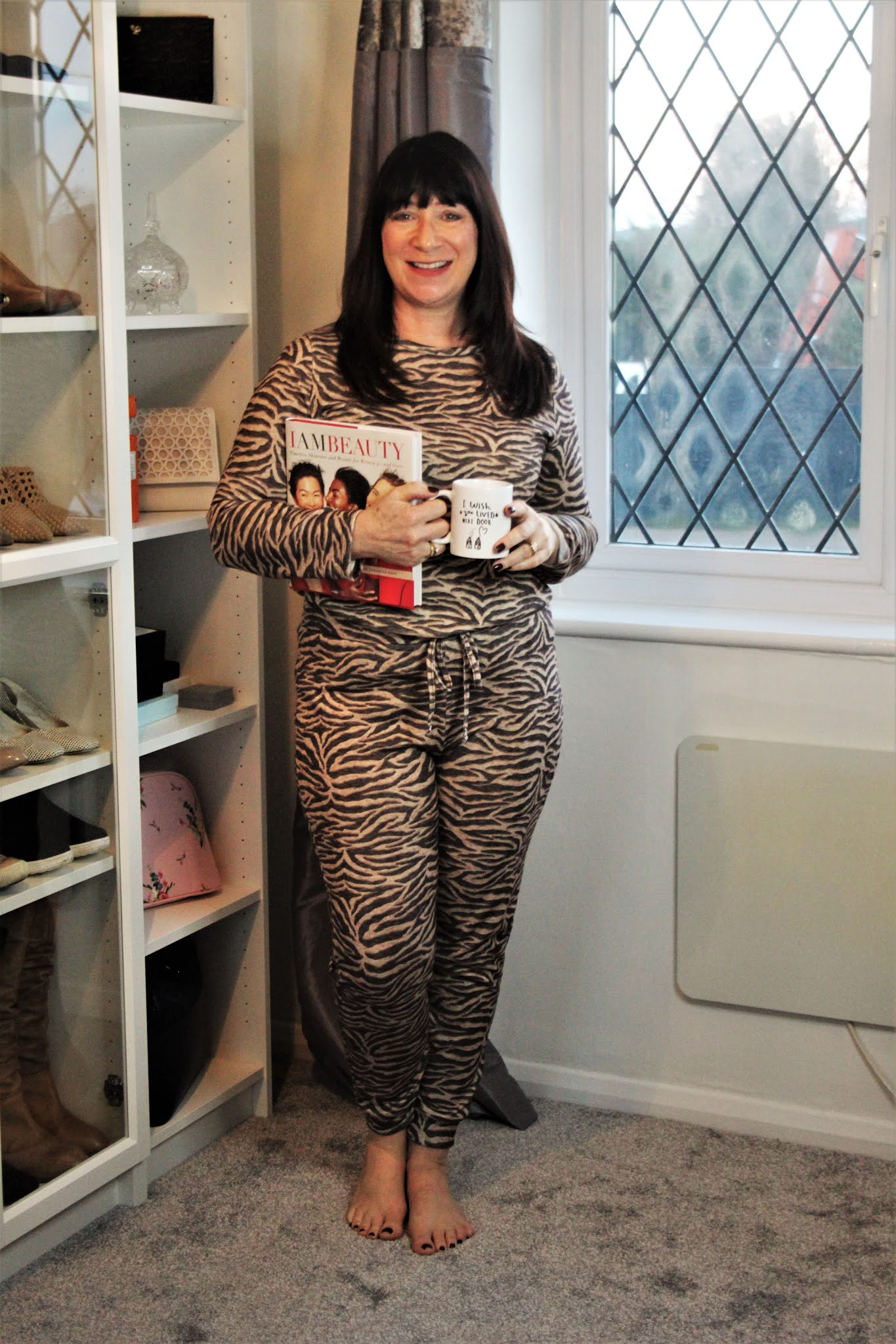 Blogger Jacqui Berry from Mummabstylish in animal print all-in-one from Bonmarche