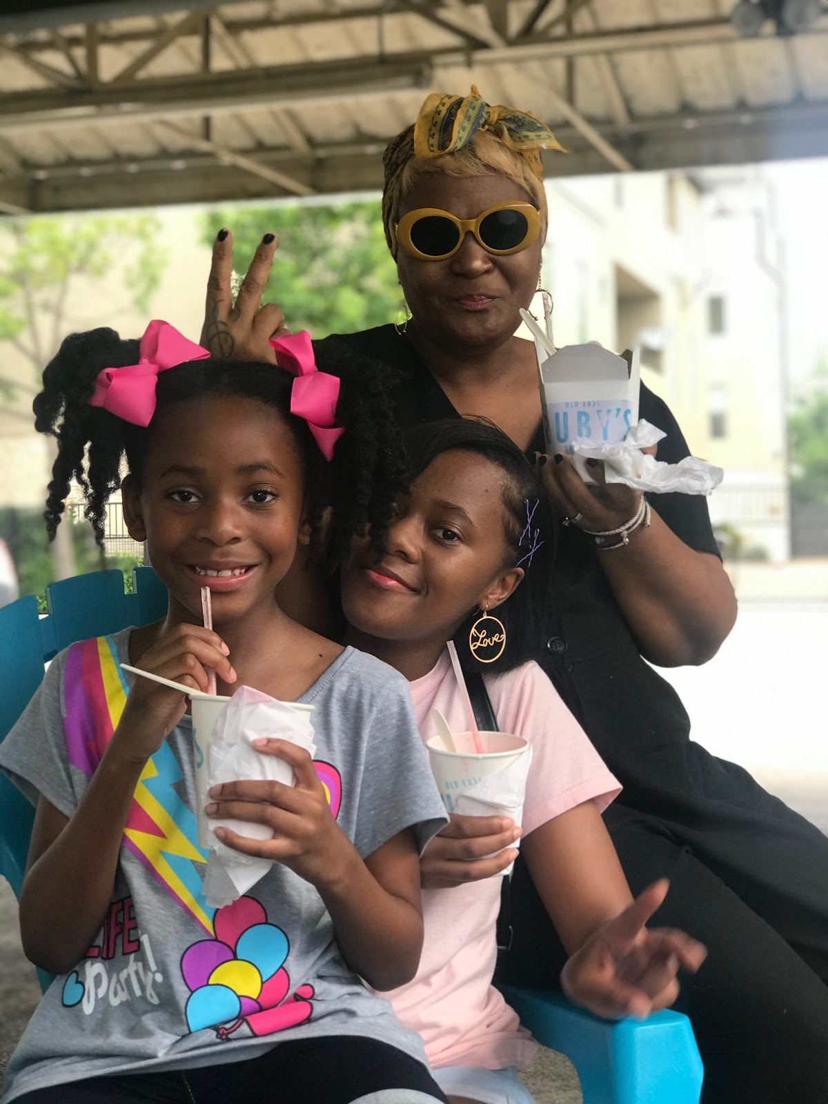 Image: Woman Tangie Bell and daughters enjoy snow cones at Ruby's in Dallas Texas . seen first on Bits and Babbles Blog