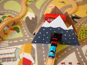 Using your DIY cardboard mountain bridge in play