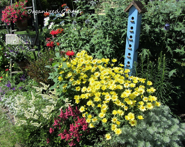 "Birdhouse ""Condo"" in the Flower Border"