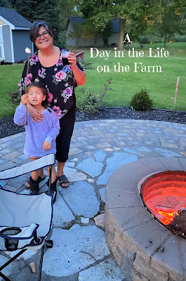 Woman and Child by firepit