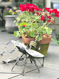 Repurposed vintage lamp into a garden bee ornament