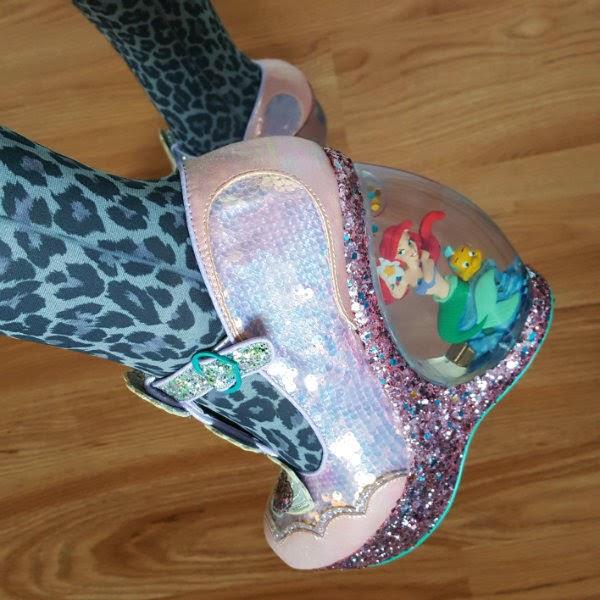 ariel figure inside glitter globe heel of shoe