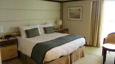 Handicapped accessible balcony cabin bed on Princess Cruises Royal Princess cruise ship