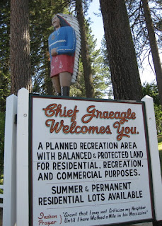 "Carved wooden Indian Chief statue atop sign ""Chief Graeagle Welcomes You."", Graeagle, California"
