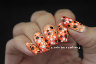 Orange polka dot nail art