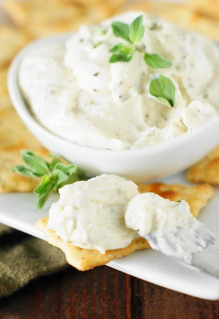 Easy-to-make savory Boursin cheese spread, beautifully flecked with herbs and black pepper.  It's so simple to make your own at home!   www.thekitchenismyplayground.com