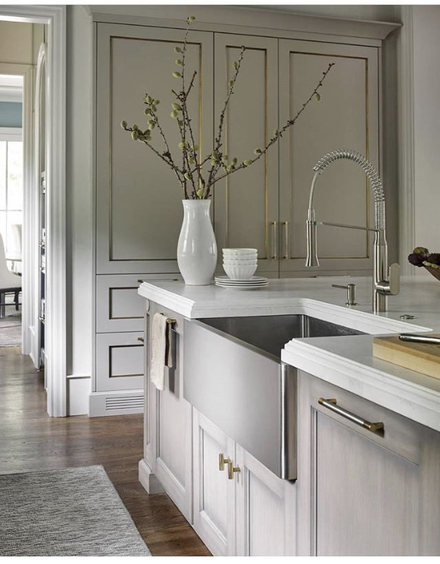 the faucet is by grohe and you can turn it on by putting your foot under the toe kick of the cabinets custom pulls are from the matthew quinn collection - Matthew Quinn Collection