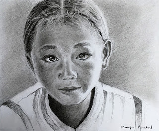 A graphite and charcoal portrait drawing of a young boyon Canson Bristol paper by Manju Panchal