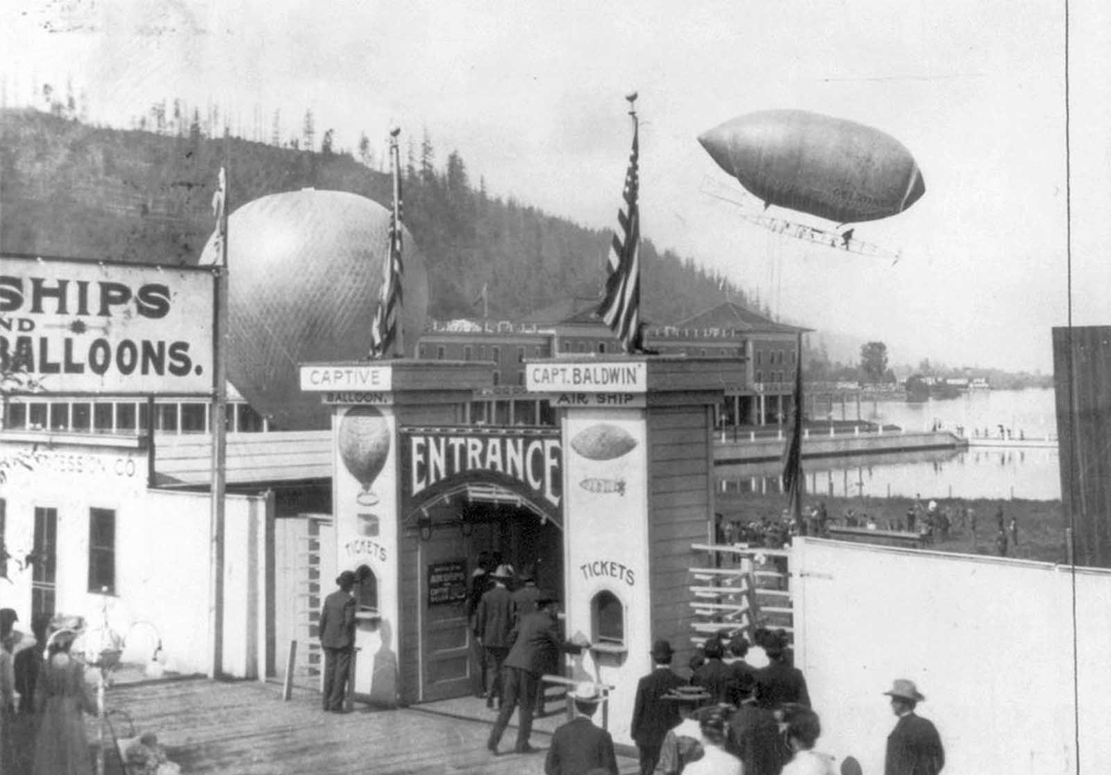 In 1905, pioneering balloonist Thomas Scott Baldwin's latest airship returns from a flight over the City of Portland, Oregon, during the Lewis and Clark Centennial Exposition.