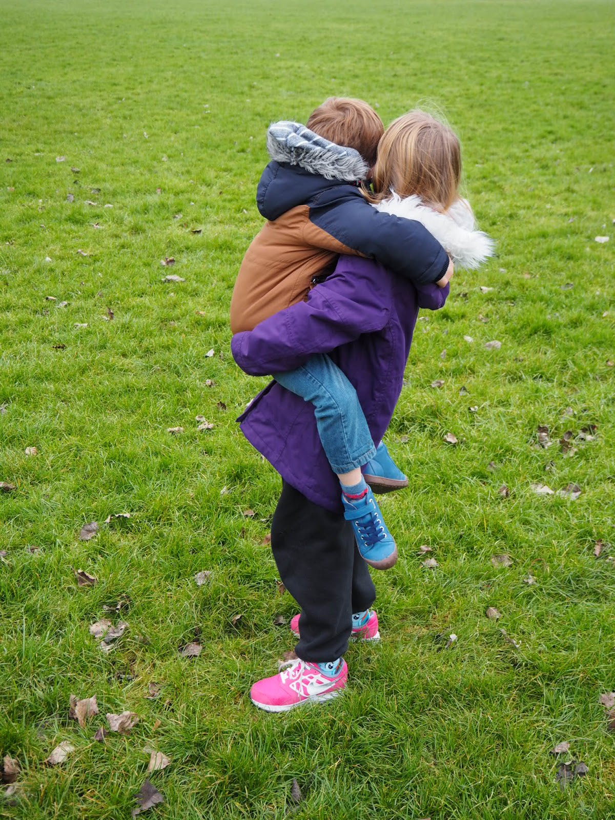 Children hugging and being kind