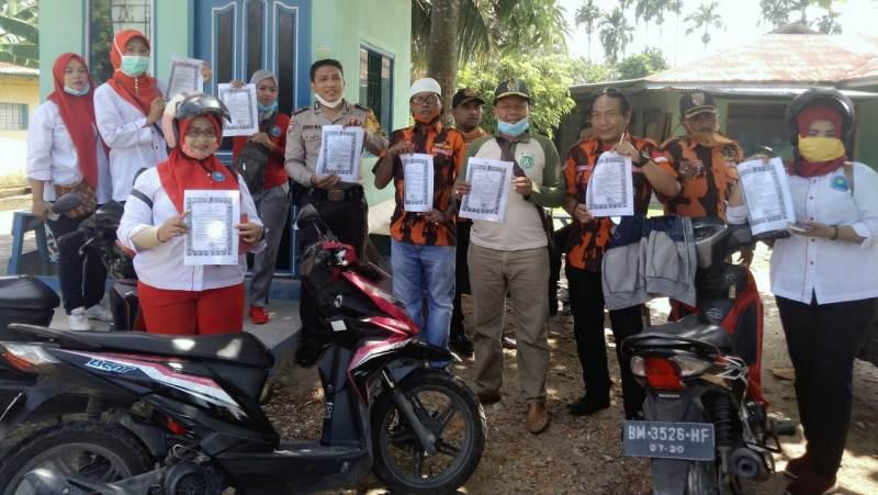 Yuhandri Dukung Kegiatan Penyemprotan Disinfektan Cegah Covid-19 di Jaya Mukti Dumai