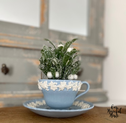 snowy faux green leaves white berries blue wedgewood tea cup