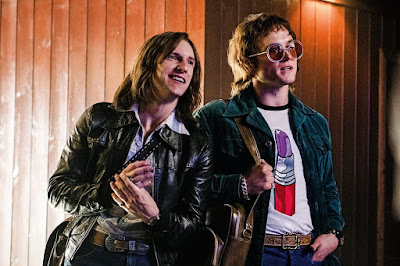 "Jamie Bell and Taron Egerton as Bernie Taupin and Elton John in the movie biopic ""Rocketman"""