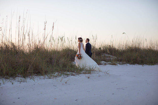 Sunset photography of couple on Fort Myers beach.
