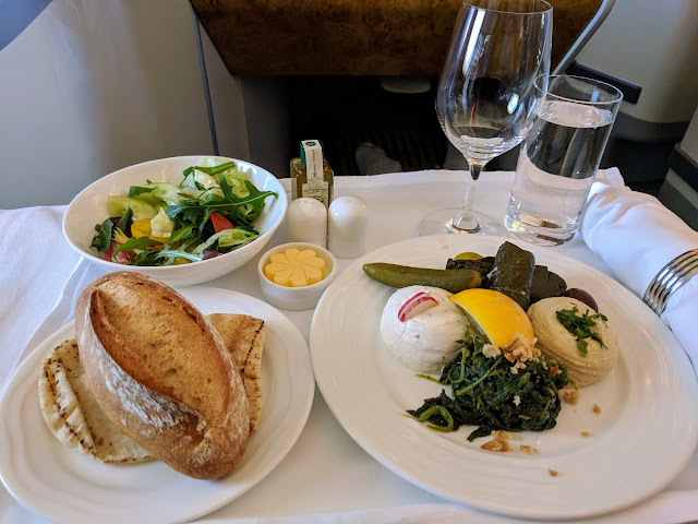 Meal service in Business Class aboard the Emirates A380